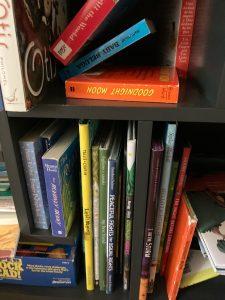 Book shelf full of children's books.